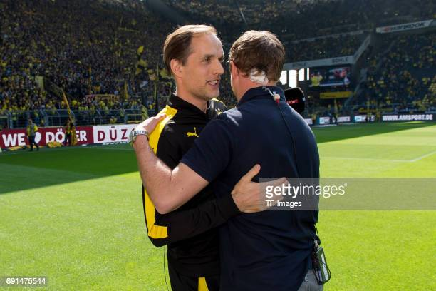 Head coach Thomas Tuchel of Dortmund shakes hands with Head coach Julian Nagelsmann of Hoffenheim during the Bundesliga match between Borussia...
