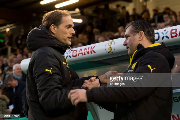 Head coach Thomas Tuchel of Dortmund shakes hands with Michael Zorc of Dortmund during the DFB Cup Quarter Final match between Sportfreunde Lotte and...