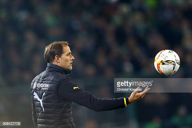 Head coach Thomas Tuchel of Dortmund throws the ball during the Bundesliga match between Borussia Moenchengladbach and Borussia Dortmund at...