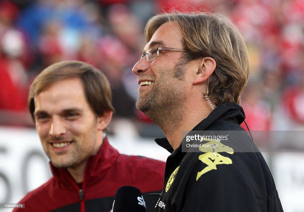 Head coach Thomas Tuchel of Mainz and head coach Juergen Klopp of Dortmund look on before the Bundesliga match between FSV Mainz 05 and Borussia Dortmund at Bruchweg Stadium on October 31, 2010 in Mainz, Germany.