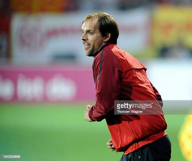 Head coach Thomas Tuchel of Mainz celebrates after winning the Bundesliga match between FSV Mainz 05 and 1FC Koeln at Bruchweg Stadium on September...