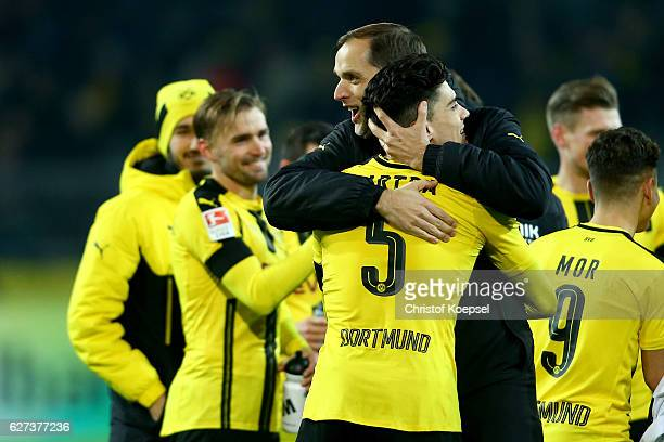Head coach Thomas Tuchelh embraces Marc Bartra of Dortmund after the Bundesliga match between Borussia Dortmund and Borussia Moenchengladbach at...