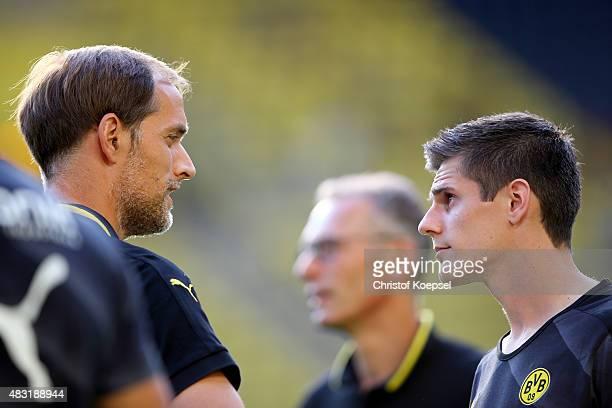 Head coach Thomas Tuchelh speaks to Jonas Hofmann of Dortmund prior to the UEFA Europa League third Qualifying round 2nd leg match between Borussia...