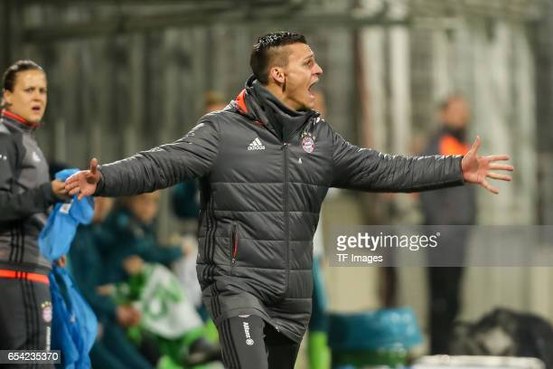 Head coach Thomas Woerle of Bayern Muenchen gestures during the Women's DFB Cup Quarter Final match between FC Bayern Muenchen and VfL Wolfsburg at...