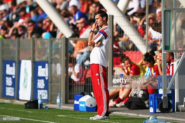 Head coach Thomas Woerle of Muenchen reacts during the Allianz FrauenBundesliga match between Bayer 04 Leverkusen and FC Bayern Muenchen at...