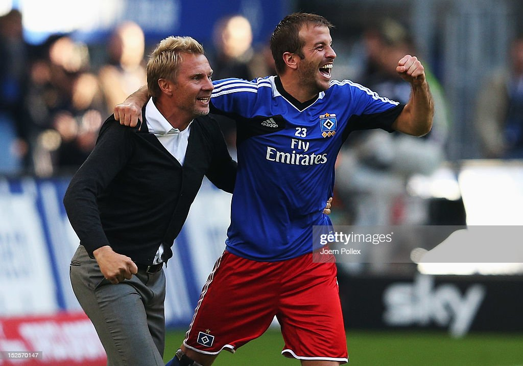 Head coach <a gi-track='captionPersonalityLinkClicked' href=/galleries/search?phrase=Thorsten+Fink&family=editorial&specificpeople=2381735 ng-click='$event.stopPropagation()'>Thorsten Fink</a> (L) and Rafael van der Vaart of Hamburg celebrate after winning the Bundesliga match between Hamburger SV and Borussia Dortmund at Imtech Arena on September 22, 2012 in Hamburg, Germany.
