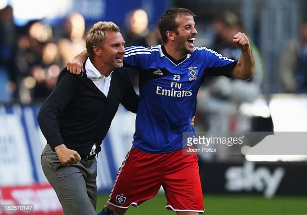 Head coach Thorsten Fink and Rafael van der Vaart of Hamburg celebrate after winning the Bundesliga match between Hamburger SV and Borussia Dortmund...