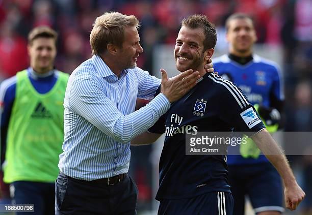 Head coach Thorsten Fink and Rafael van der Vaart of Hamburg celebrate after the Bundesliga match between 1 FSV Mainz 05 and Hamburger SV at Coface...