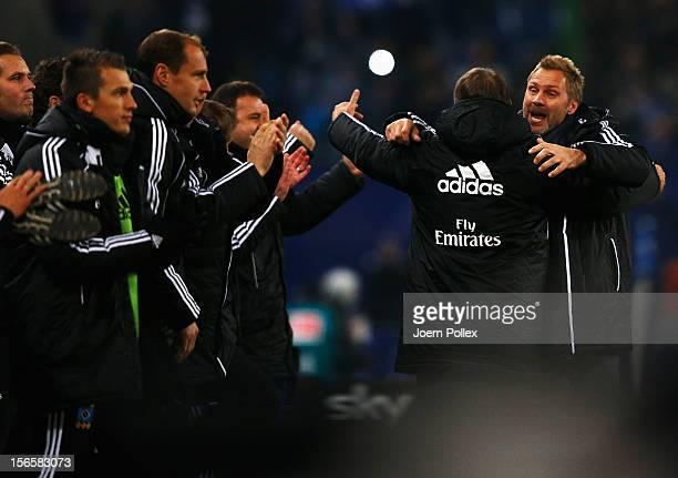 Head coach Thorsten Fink and sportdirector Frank Arnesen of Hamburg celebrate after the Bundesliga match between Hamburger SV and 1 FSV Mainz 05 at...