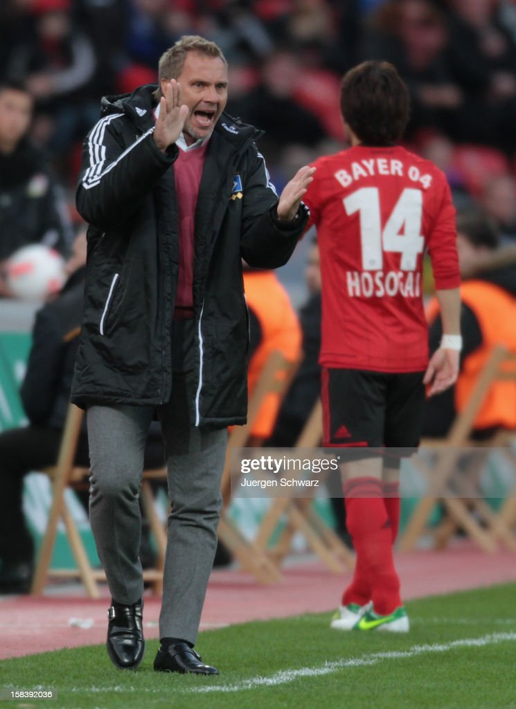Head coach <a gi-track='captionPersonalityLinkClicked' href=/galleries/search?phrase=Thorsten+Fink&family=editorial&specificpeople=2381735 ng-click='$event.stopPropagation()'>Thorsten Fink</a> of Hamburg applauds during the Bundesliga match between Bayer Leverkusen and Hamburger SV at BayArena on December 15, 2012 in Leverkusen, Germany.