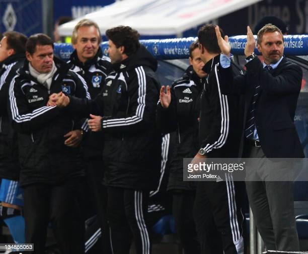 Head coach Thorsten Fink of Hamburg celebrates after the Bundesliga match between Hamburger SV and 1 FC Nuernberg at Imtech Arena on December 4 2011...