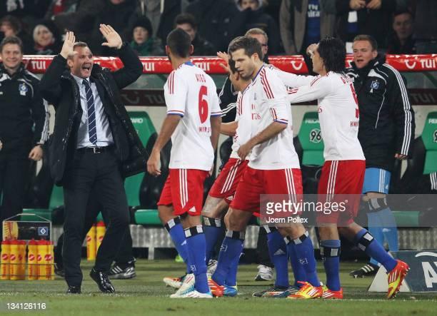 Head coach Thorsten Fink of Hamburg celebrates with his team after Jeffrey Bruma of Hamburg scored his team's first goal during the Bundesliga match...