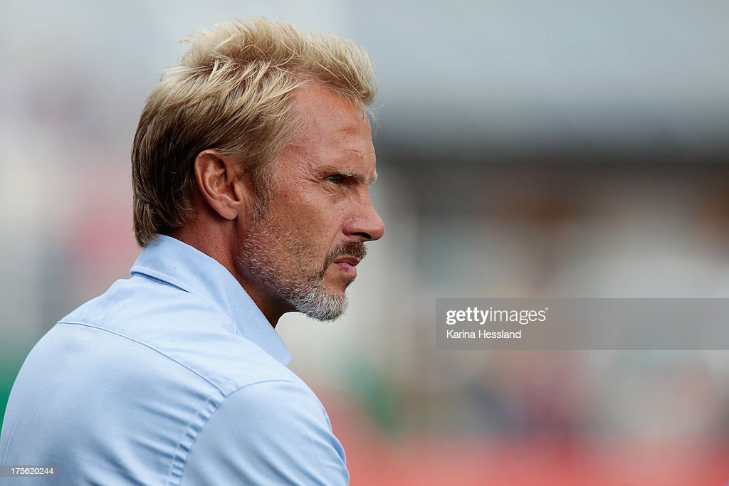 Head Coach <a gi-track='captionPersonalityLinkClicked' href=/galleries/search?phrase=Thorsten+Fink&family=editorial&specificpeople=2381735 ng-click='$event.stopPropagation()'>Thorsten Fink</a> of Hamburg during the DFB Cup between SV Schott Jena and Hamburger SV at Ernst-Abbe-Sportfeld on August 04, 2013 in Jena,Germany.