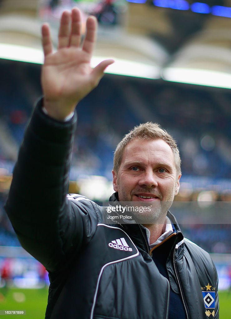 Head coach <a gi-track='captionPersonalityLinkClicked' href=/galleries/search?phrase=Thorsten+Fink&family=editorial&specificpeople=2381735 ng-click='$event.stopPropagation()'>Thorsten Fink</a> of Hamburg waves to the fans prior to the Bundesliga match between Hamburger SV and FC Augsburg at Imtech Arena on March 16, 2013 in Hamburg, Germany.