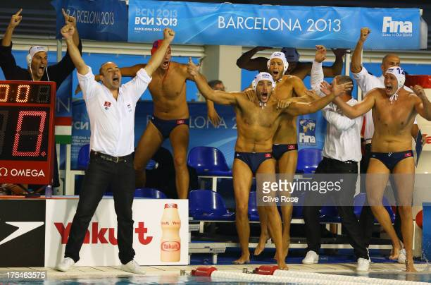 Head coach Tibor Benedek of Hungary celebrates with his players after victory in the Water Polo Men's Gold Medal Match between Hungary and Montenegro...