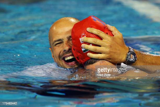 Head coach Tibor Benedek of Hungary celebrates with Viktor Nagy of Hungary after victory in the Water Polo Men's Gold Medal Match between Hungary and...