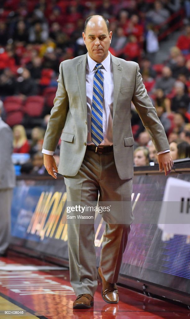 Head coach Tim Duryea of the Utah State Aggies stands on the court during his team's game against the UNLV Rebels at the Thomas & Mack Center on January 6, 2018 in Las Vegas, Nevada. Utah State won 85-78.