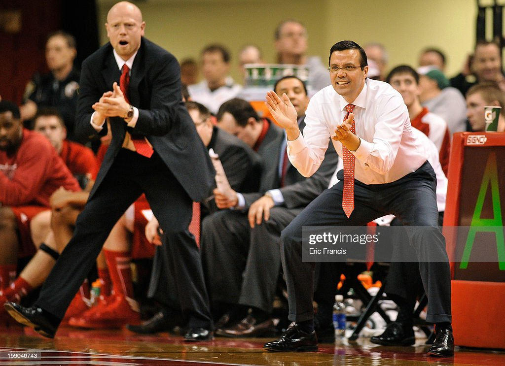 Head coach Tim Miles of the Nebraska Cornhuskers and assistant Chris Harriman encourage their team during their game against the Wisconsin Badgers at the Devaney Center on January 6, 2013 in Lincoln, Nebraska. Wisconsin defeated Nebraska 47-41.