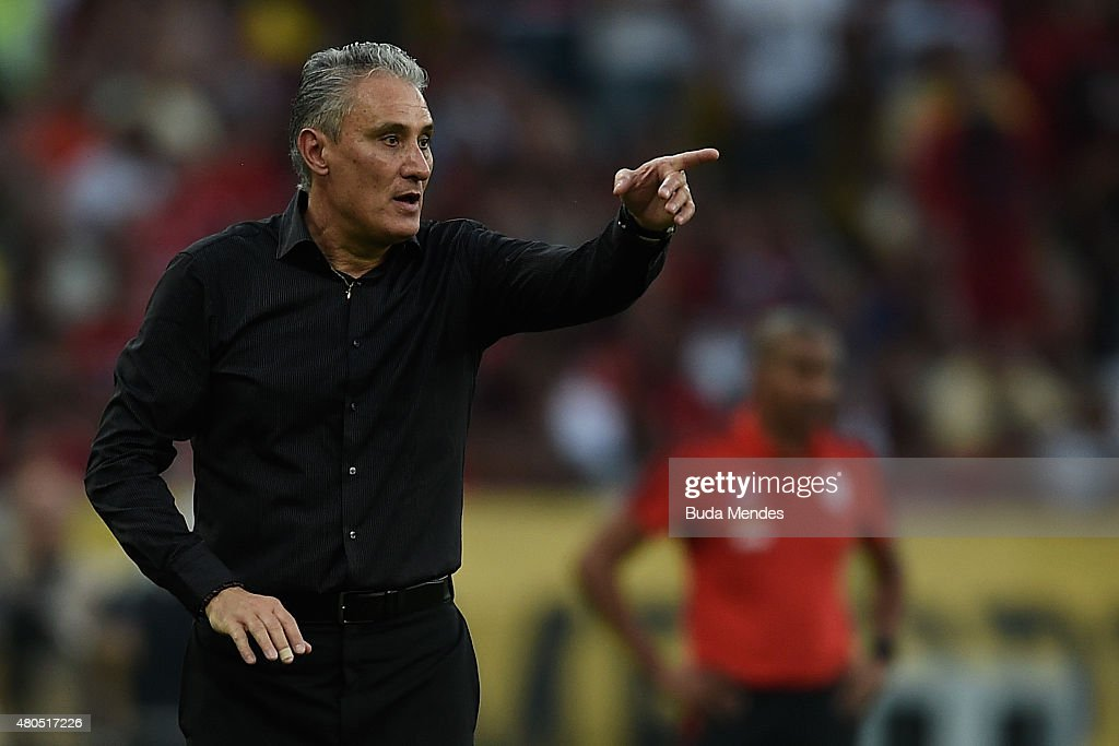 Head coach <a gi-track='captionPersonalityLinkClicked' href=/galleries/search?phrase=Tite+-+Entrenador+de+f%C3%BAtbol+brasile%C3%B1o&family=editorial&specificpeople=10072994 ng-click='$event.stopPropagation()'>Tite</a> of Corinthians gestures during a match between Flamengo and Corinthians as part of Brasileirao Series A 2015 at Maracana Stadium on July 12, 2015 in Rio de Janeiro, Brazil.