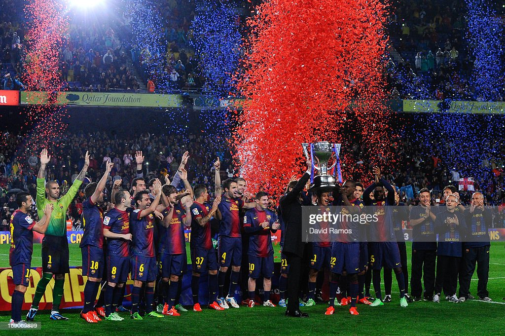 Head coach <a gi-track='captionPersonalityLinkClicked' href=/galleries/search?phrase=Tito+Vilanova&family=editorial&specificpeople=5807709 ng-click='$event.stopPropagation()'>Tito Vilanova</a> and Eric Abidal of FC Barcelona holds up the trophy during the celebration after winning the Spanish League after the La Liga match between FC Barcelona and Real Valladolid CF at Camp Nou on May 19, 2013 in Barcelona, Spain.