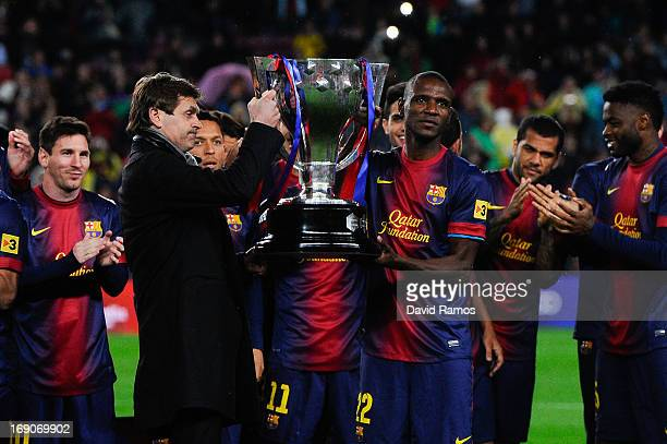 Head coach Tito Vilanova and Eric Abidal of FC Barcelona holds up the trophy during the celebration after winning the Spanish League after the La...