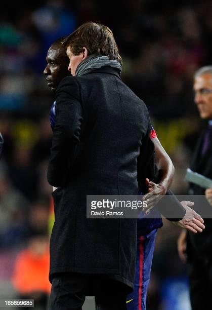 Head coach Tito Vilanova of FC Barcelona hugs Eric Abidal of FC Barcelona during the La Liga match between FC Barcelona and RCD Mallorca at Camp Nou...