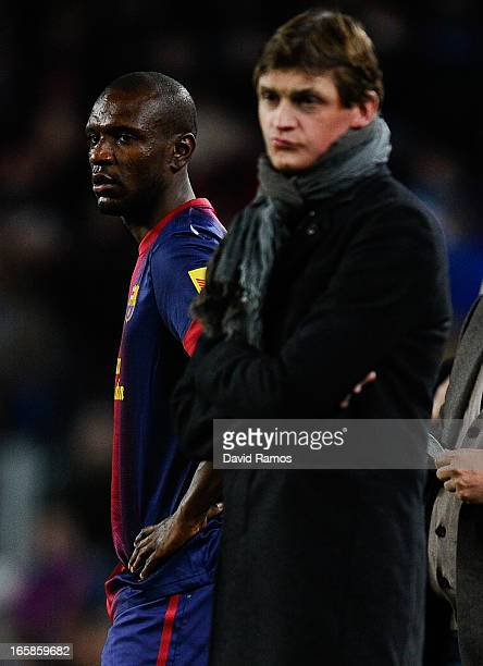 Head coach Tito Vilanova of FC Barcelona looks on as Eric Abidal of FC Barcelona waits for coming on for his teammate Gerard Pique during the La Liga...