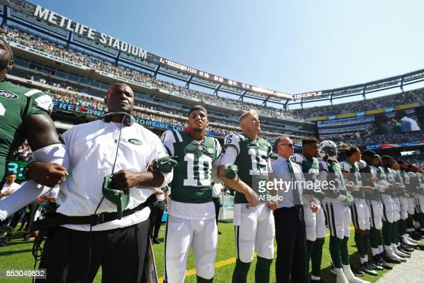 Head coach Todd Bowles of the New York Jets stands in unison with his team during the National Anthem prior to an NFL game against the Miami Dolphins...
