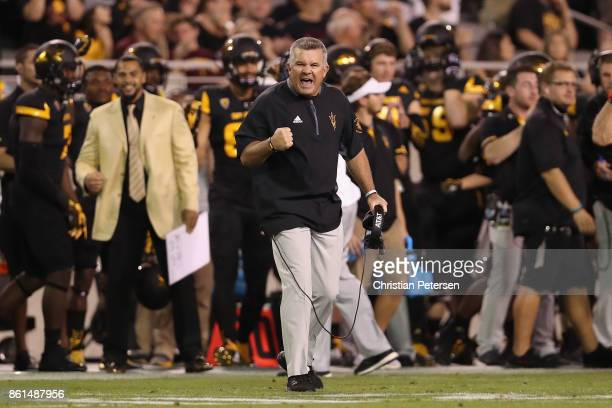 Head coach Todd Graham of the Arizona State Sun Devils celebrates after the Washington Huskies missed a field goal during the second half of the...