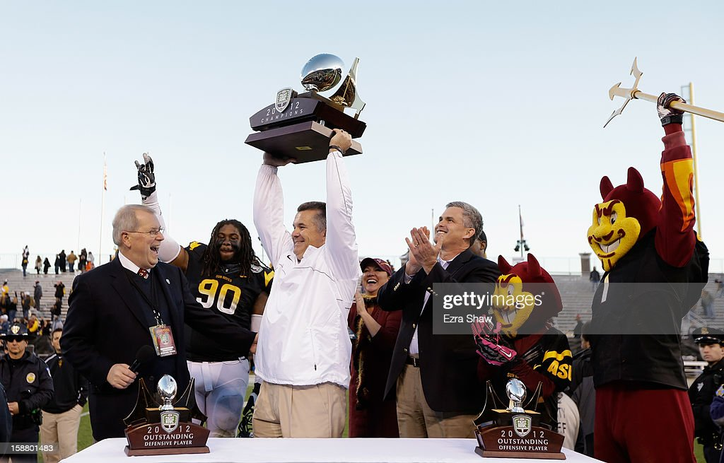 Head coach Todd Graham of the Arizona State Sun Devils lifts the trophy after they beat the Navy Midshipmen in the Kraft Fight Hunger Bowl at AT&T Park on December 29, 2012 in San Francisco, California.