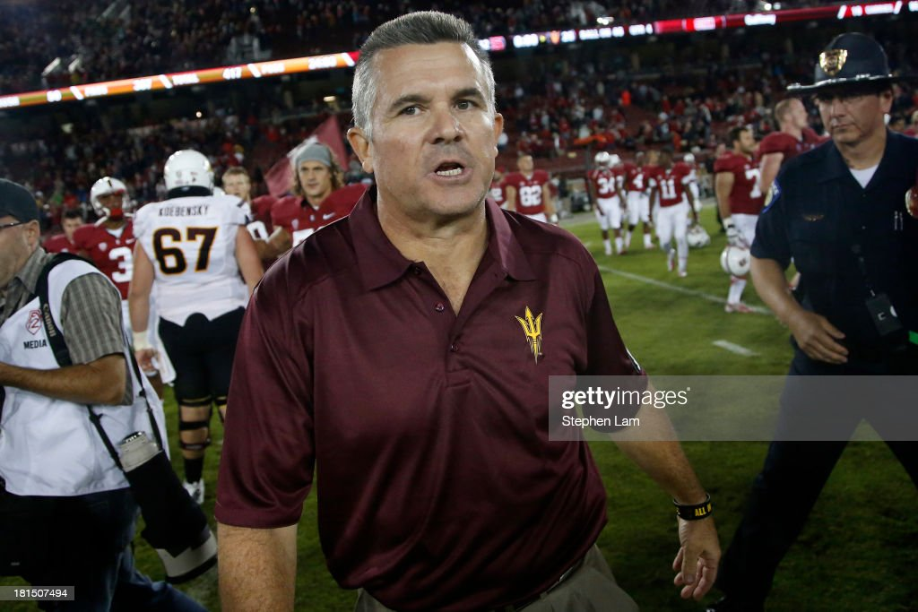 Head coach Todd Graham of the Arizona State Sun Devils walks on the field after being defeated by the Stanford Cardinal 42-28 at Stanford Stadium on September 21, 2013 in Stanford, California.
