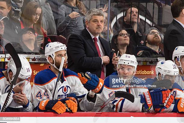 Head coach Todd McLellan of the Edmonton Oilers looks on from the bench during an NHL game against the Ottawa Senators at Canadian Tire Centre on...