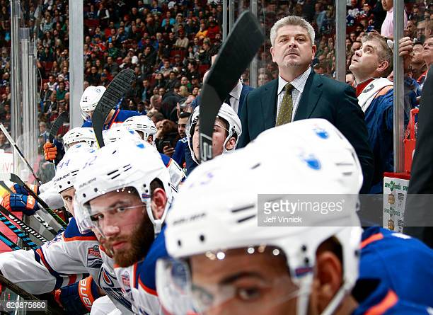 Head coach Todd McLellan of the Edmonton Oilers looks on from the bench during their NHL game against the Vancouver Canucks at Rogers Arena October...
