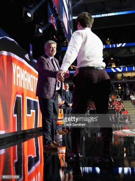 Head coach Todd McLellan of the Edmonton Oilers shakes hands with Kailer Yamamoto after he was selected 22nd overall during Round One of the 2017 NHL...