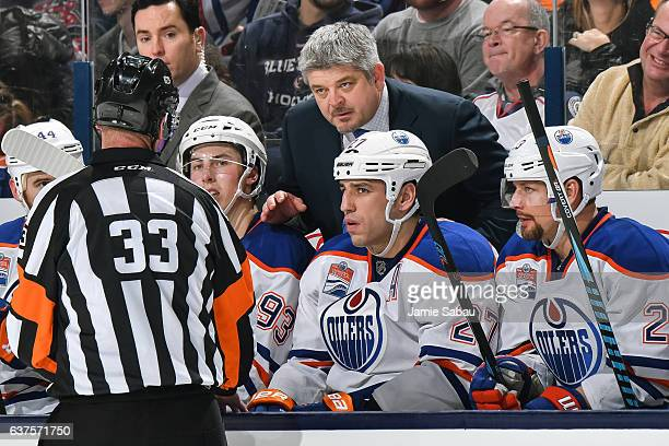 Head Coach Todd McLellan of the Edmonton Oilers talks with a referee during a game against the Columbus Blue Jackets on January 3 2017 at Nationwide...
