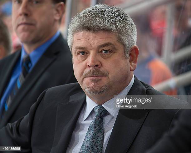 Head coach Todd McLellan of the Edmonton Oilers watches the action from the bench during an NHL game against the Detroit Red Wings at Joe Louis Arena...