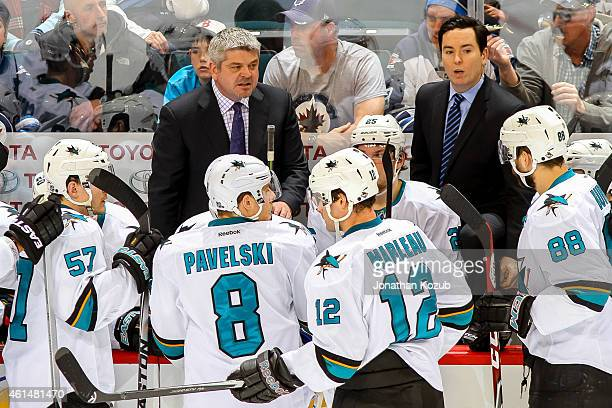Head Coach Todd McLellan of the San Jose Sharks instructs his players during a third period stoppage in play against the Winnipeg Jets on January 5...