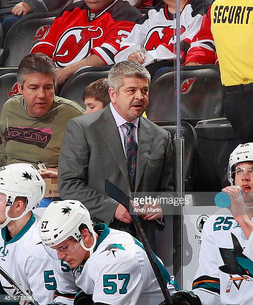 Head coach Todd McLellan of the San Jose Sharks looks on against the New Jersey Devils during the game at the Prudential Center on October 18 2014 in...
