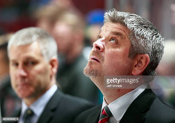 Head coach Todd McLellan of the San Jose Sharks looks on from the bench during their NHL game against the Vancouver Canucks at Rogers Arena March 3...