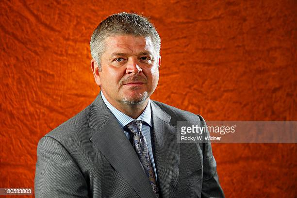 Head coach Todd McLellan of the San Jose Sharks poses for a portrait on media day at the San Jose Sharks practice facility on September 11 2013 in...