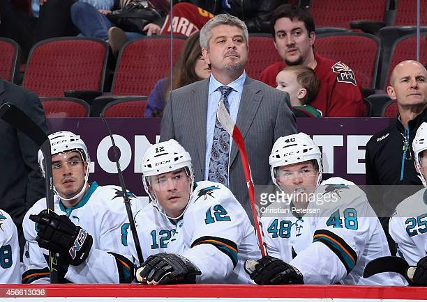 Head coach Todd McLellan of the San Jose Sharks watches from the bench during the first period of the preseason NHL game against the Arizona Coyotes...