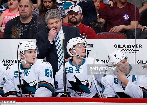 Head coach Todd McLellan of the San Jose Sharks watches from the bench during the first period of the NHL game against the Arizona Coyotes at Gila...