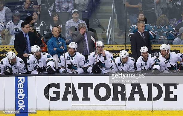 Head coach Todd McLellan of the San Jose Sharks wipes his brow during Game Three of the First Round of the 2014 NHL Stanley Cup Playoffs at Staples...