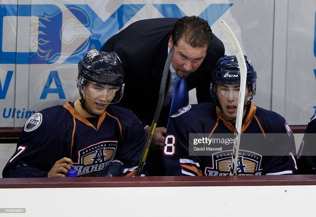 Head coach Todd Nelson of the Oklahoma City Barons talks with players <a gi-track='captionPersonalityLinkClicked' href=/galleries/search?phrase=Ryan+Nugent-Hopkins&family=editorial&specificpeople=7144190 ng-click='$event.stopPropagation()'>Ryan Nugent-Hopkins</a> #18 and <a gi-track='captionPersonalityLinkClicked' href=/galleries/search?phrase=Jordan+Eberle&family=editorial&specificpeople=4898161 ng-click='$event.stopPropagation()'>Jordan Eberle</a> #7 during a game against the Lake Erie Monsters on October 12, 2012 at Quicken Loans Arena in Cleveland, Ohio.