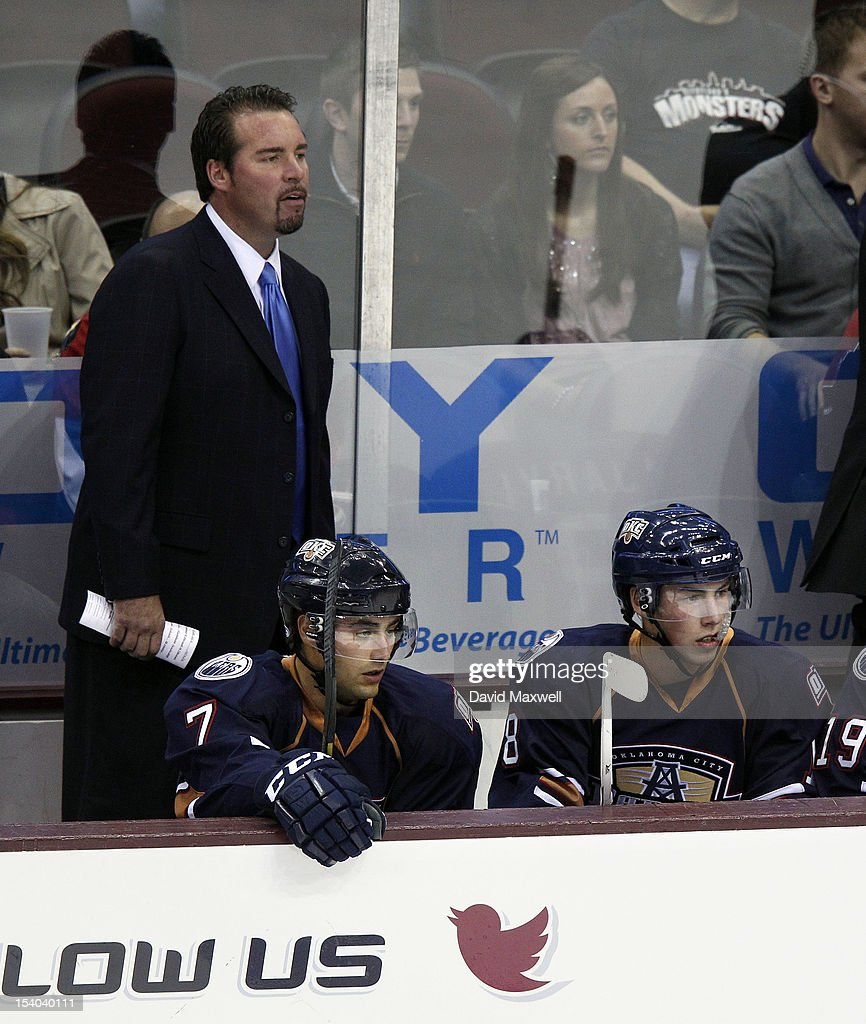 Head coach Todd Nelson of the Oklahoma City Barons watches from the bench with players <a gi-track='captionPersonalityLinkClicked' href=/galleries/search?phrase=Ryan+Nugent-Hopkins&family=editorial&specificpeople=7144190 ng-click='$event.stopPropagation()'>Ryan Nugent-Hopkins</a> #18 and <a gi-track='captionPersonalityLinkClicked' href=/galleries/search?phrase=Jordan+Eberle&family=editorial&specificpeople=4898161 ng-click='$event.stopPropagation()'>Jordan Eberle</a> #7 during their game against the Lake Erie Monsters on October 12, 2012 at Quicken Loans Arena in Cleveland, Ohio.