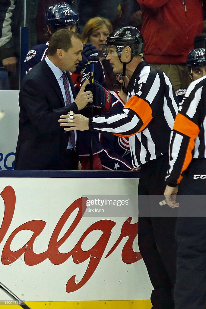 Head Coach Todd Richards of the Columbus Blue Jackets argues a call with referee Dan O'Rourke #9 during the game against the Chicago Blackhawks on January 26, 2013 at Nationwide Arena in Columbus, Ohio.