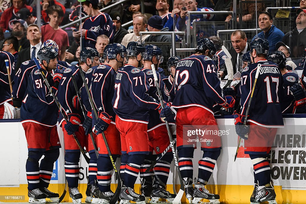 Head Coach Todd Richards of the Columbus Blue Jackets talks with his team during a time out against the New York Rangers on November 7, 2013 at Nationwide Arena in Columbus, Ohio.