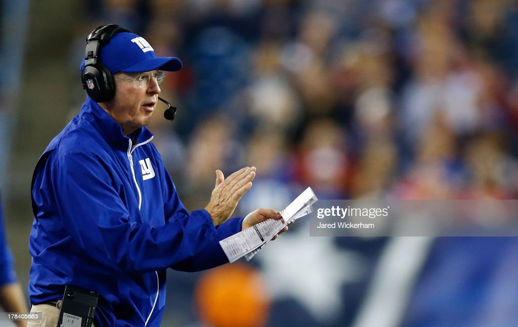 Head coach <a gi-track='captionPersonalityLinkClicked' href=/galleries/search?phrase=Tom+Coughlin&family=editorial&specificpeople=206312 ng-click='$event.stopPropagation()'>Tom Coughlin</a> of the New York Giants cheers his team on against the New England Patriots during the preseason game at Gillette Stadium on August 29, 2013 in Foxboro, Massachusetts.