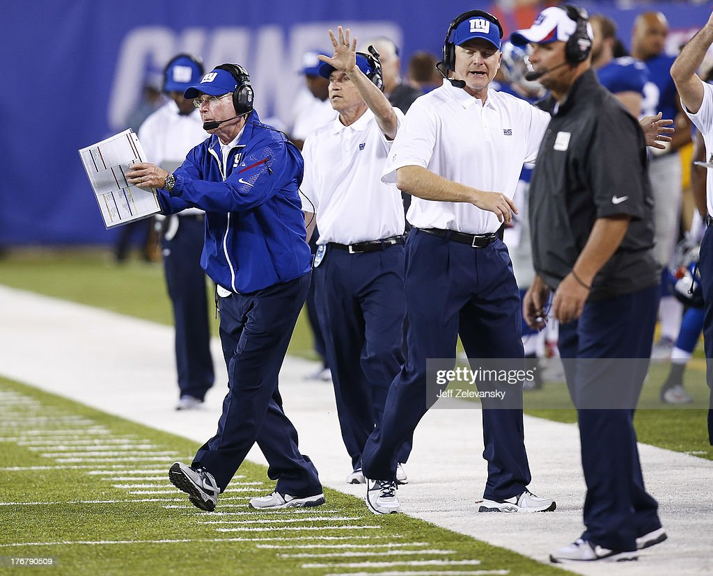 Head coach <a gi-track='captionPersonalityLinkClicked' href=/galleries/search?phrase=Tom+Coughlin&family=editorial&specificpeople=206312 ng-click='$event.stopPropagation()'>Tom Coughlin</a> of the New York Giants works on the sidelines during their preseason game against the Indianapolis Colts at MetLife Stadium on August 18, 2013 in East Rutherford, New Jersey.