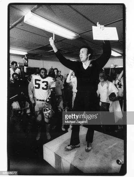 Head coach Tom Flores of the Oakland Raiders celebrates in the locker room following Super Bowl XV against the Philadelphia Eagles at the Louisiana...